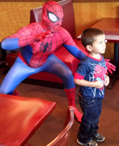 Spiderman & boy in restaurant