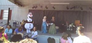 Olaf Elsa and Anna entertaining on stage